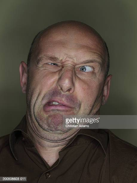mature man making funny face, close-up - ugly bald man stock photos and pictures