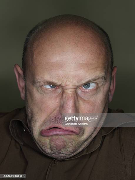 mature man making funny face, close-up - ugly bald man stock pictures, royalty-free photos & images
