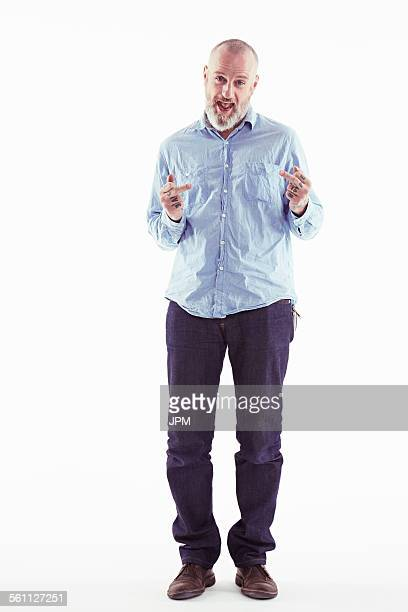 Mature man making obscene gesture with hands, white background