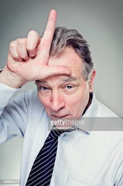 Mature Man Making the 'L' for Loser Sign