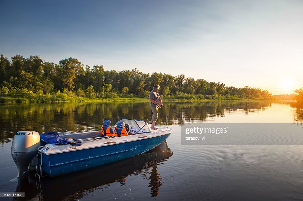 Mature man on a motor boat. Fishing. : Stock Photo
