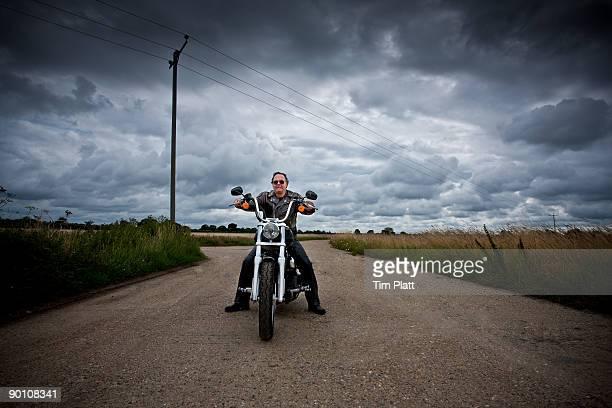 mature man on a motorcycle. - のりものに乗る ストックフォトと画像