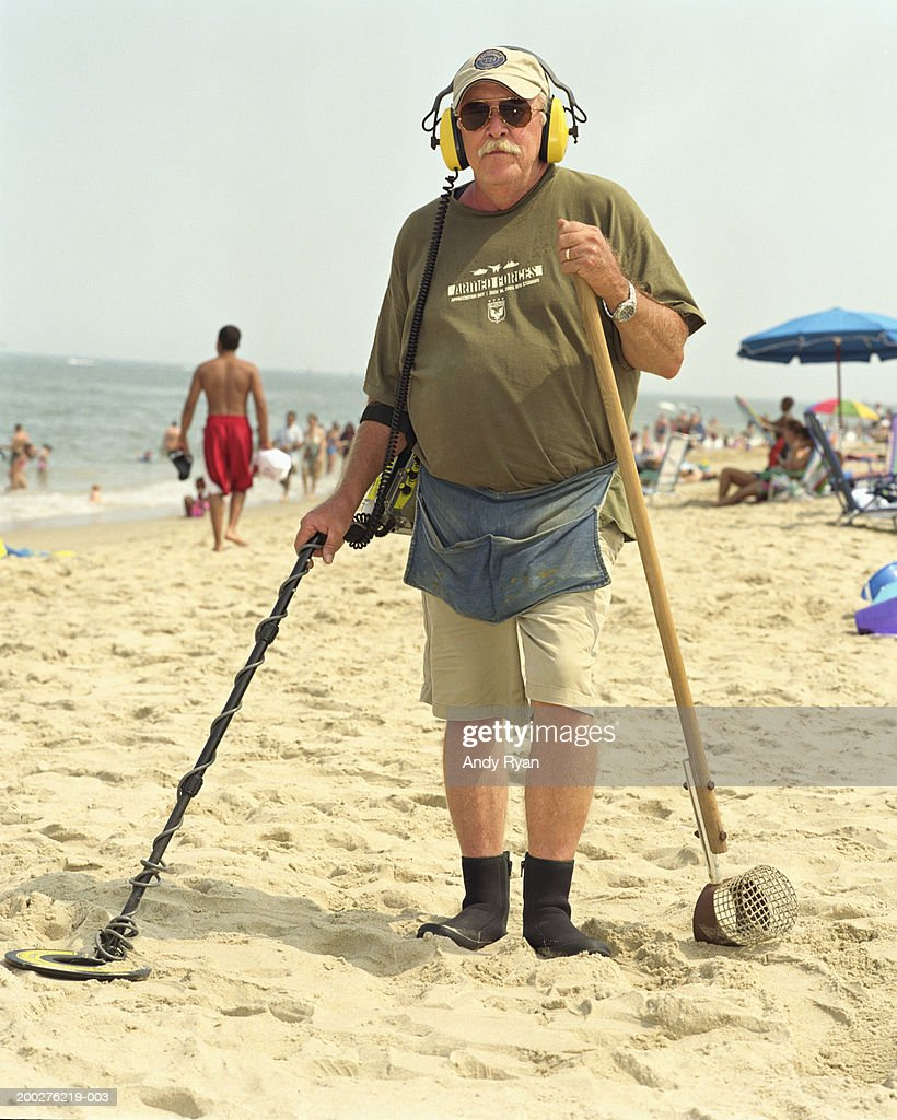 Jew Detector: Mature Man On Beach With Metal Detector Portrait Stock