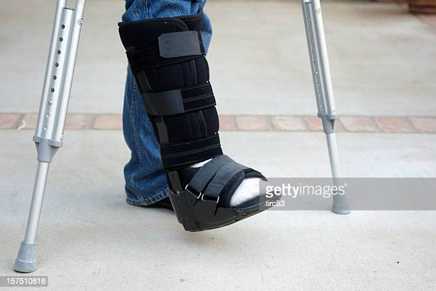 mature man on crutches - crutch stock photos and pictures