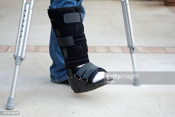 Mature man on crutches