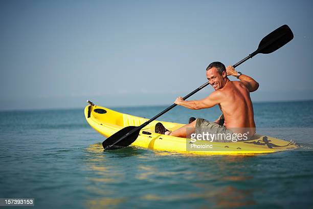 Mature man on kayak in the sea