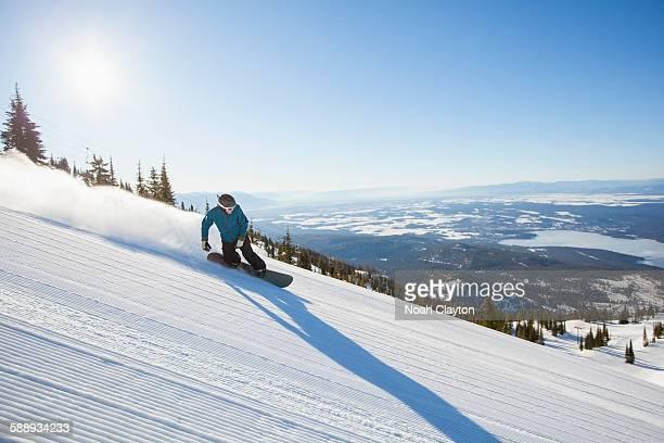Mature man on ski slope at sunlight
