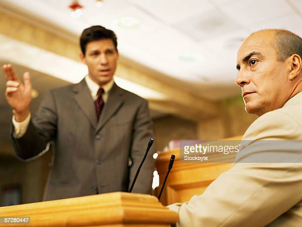 mature man on the witness stand, testifying - witness stock pictures, royalty-free photos & images