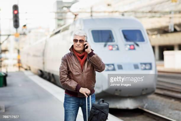 Mature man on train station