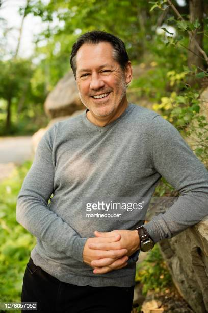 """mature man outdoors portrait in summer nature. - """"martine doucet"""" or martinedoucet stock pictures, royalty-free photos & images"""