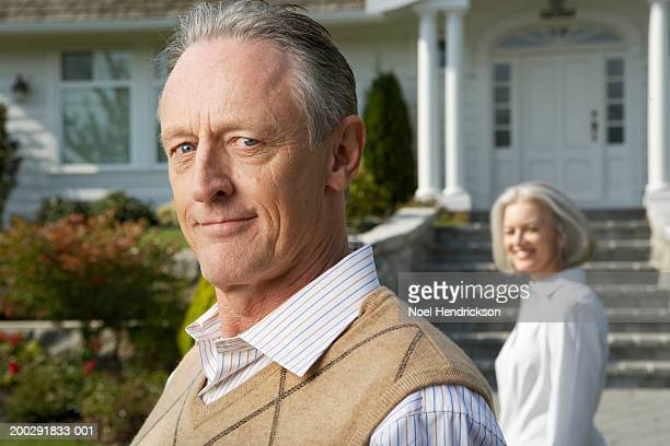mature man outside house, smiling, portrait, close-up - sweater vest stock photos and pictures