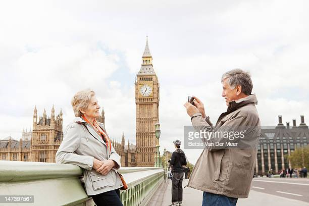 mature man photograph woman, big ben in background - tourist stock pictures, royalty-free photos & images