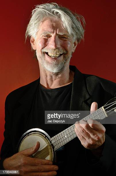 mature man playing banjo - depczyk stock pictures, royalty-free photos & images