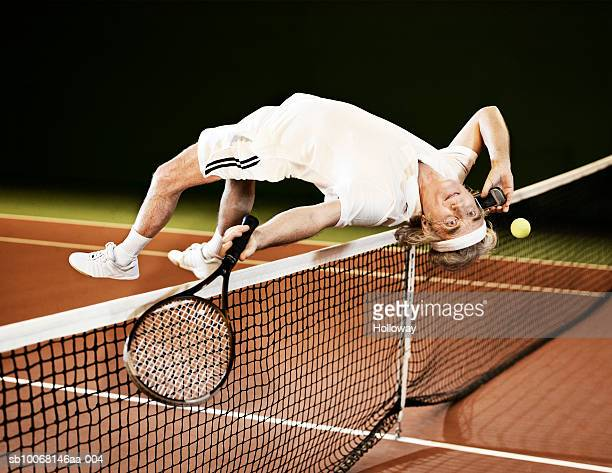 mature man playing tennis and using mobile phone - multitasking stock pictures, royalty-free photos & images