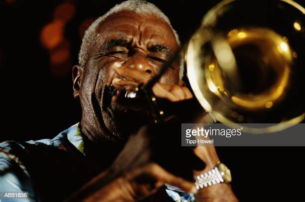 mature man playing trumpet, close up - jazz stock pictures, royalty-free photos & images