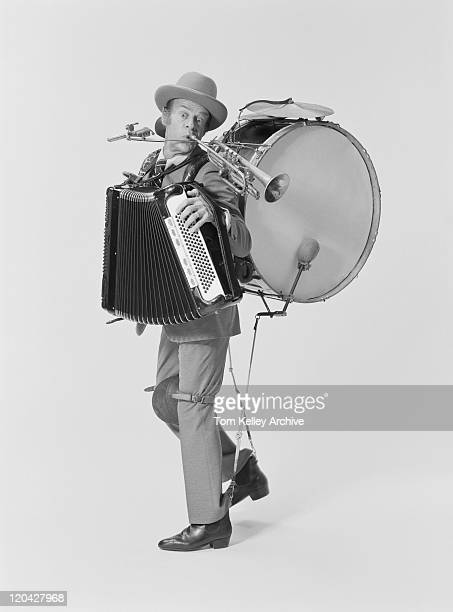 mature man playing variety of musical instruments on white background, portrait - accordion instrument stock pictures, royalty-free photos & images