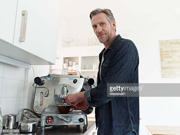 Mature man preparing espresso with espresso machine