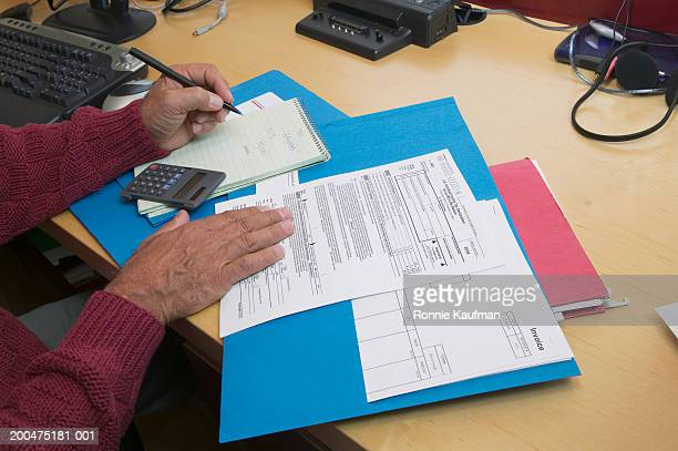 mature man preparing tax forms, close-up - tax stock pictures, royalty-free photos & images