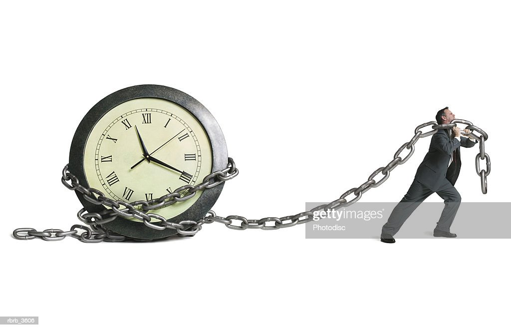 Mature man pulling a clock : Foto de stock