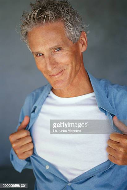 mature man pulling shirt open, portrait - fully unbuttoned stock pictures, royalty-free photos & images