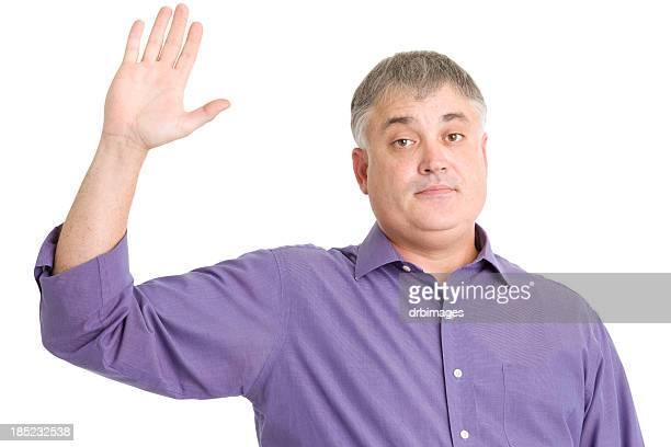 Mature Man Raises Hand