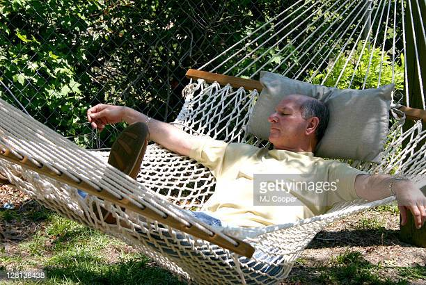 A mature man relaxing in a hammock