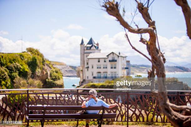 mature man relaxing in biarritz, france - biarritz stock pictures, royalty-free photos & images