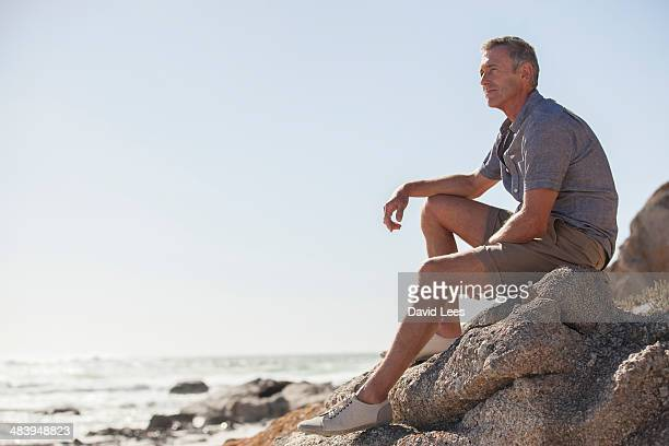 Mature man relaxing on beach