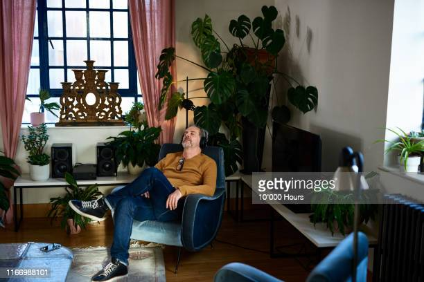 mature man resting and listening to music - enjoyment stock pictures, royalty-free photos & images
