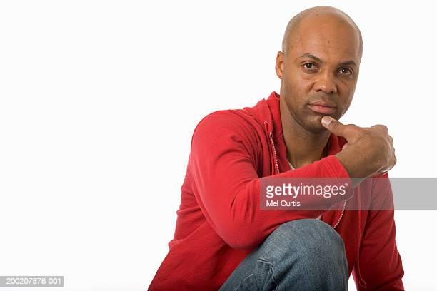 Mature man resting chin on hand, portrait