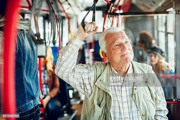 mature man riding in a bus - public transport stock pictures, royalty-free photos & images