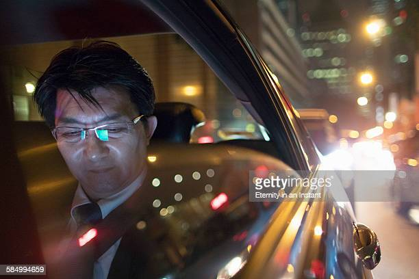 Mature man riding in a car