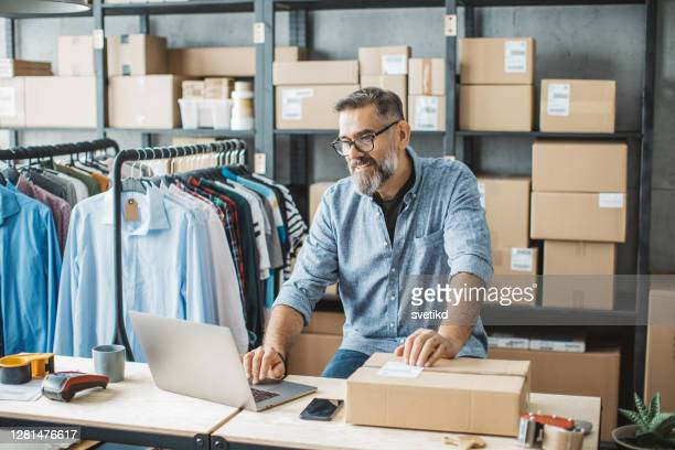 mature man running online store - entrepreneur stock pictures, royalty-free photos & images