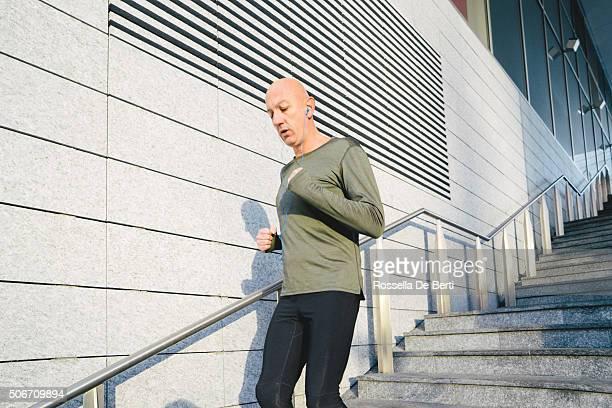 Mature Man Running Outdoors Wearing Sport Clothes