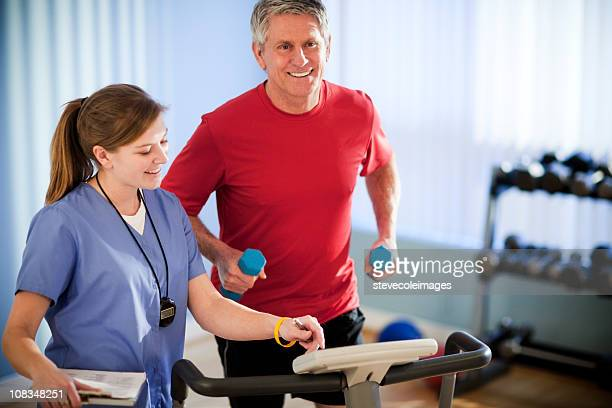 Mature Man Running With Dumbbells for Physical Therapy