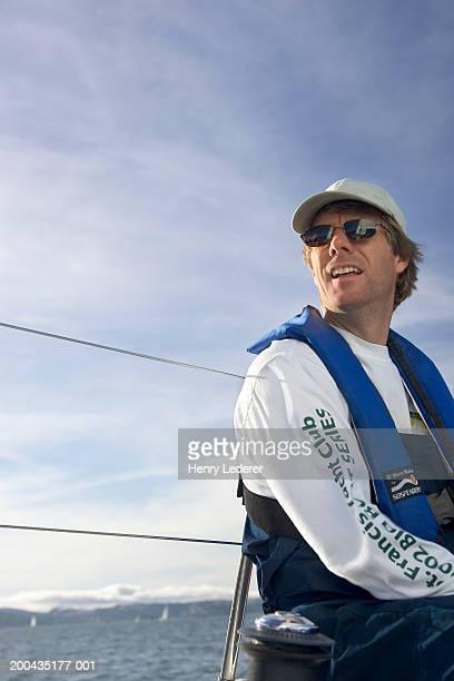 Mature man sailing