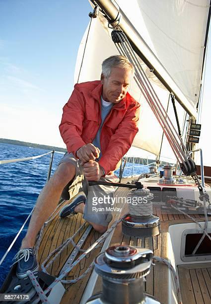 mature man sailing - kitsap county washington state stock pictures, royalty-free photos & images