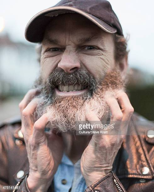 Mature man scratching beard