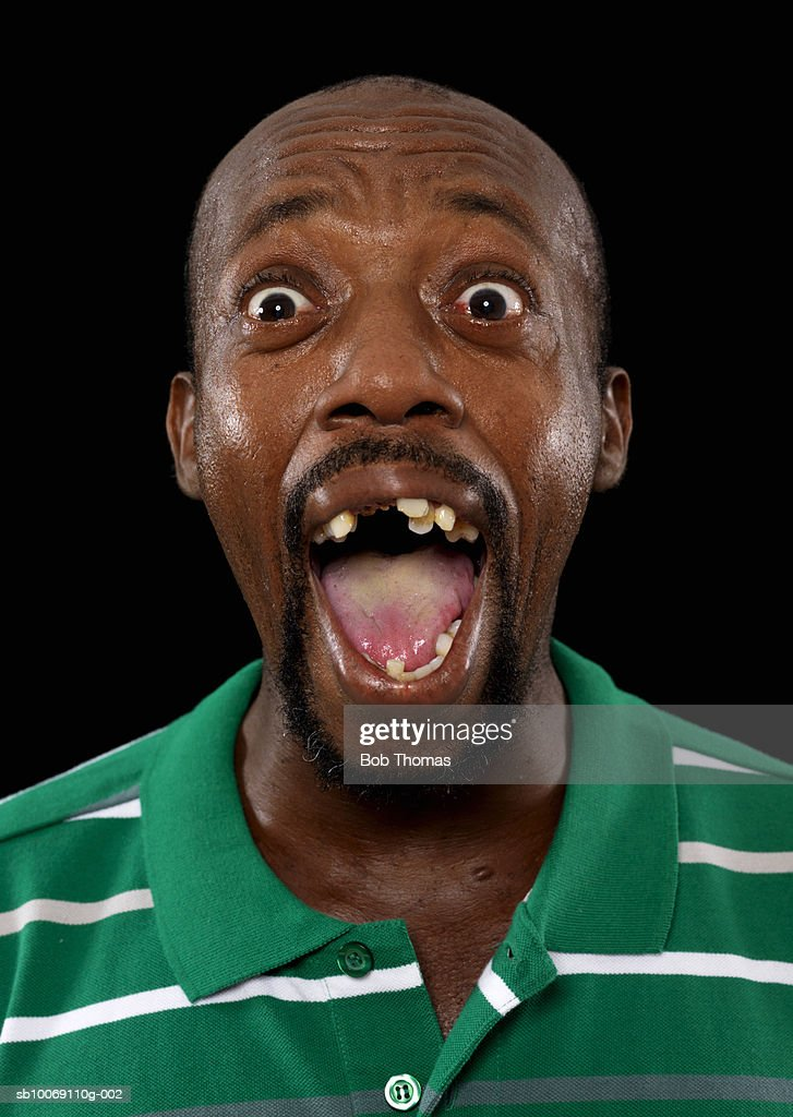 Mature man screaming, mouth open, close-up : Stockfoto