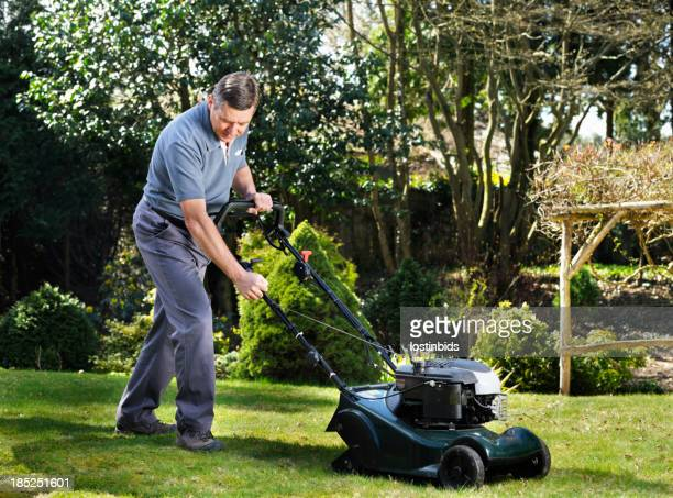 Mature Man/ Senior Mowing The Lawn