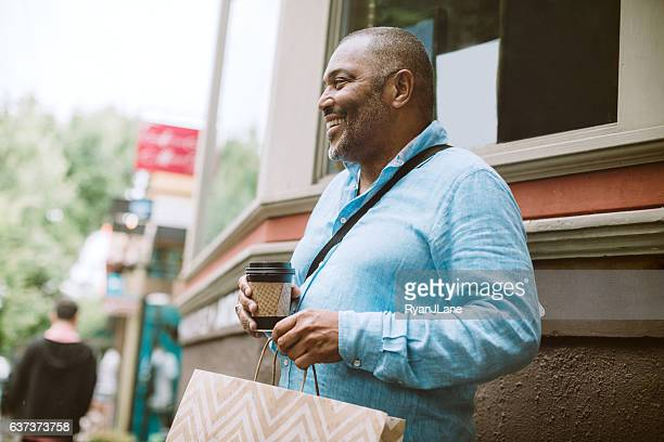 Mature Man Shopping in City