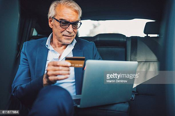 Mature man shopping with credit card