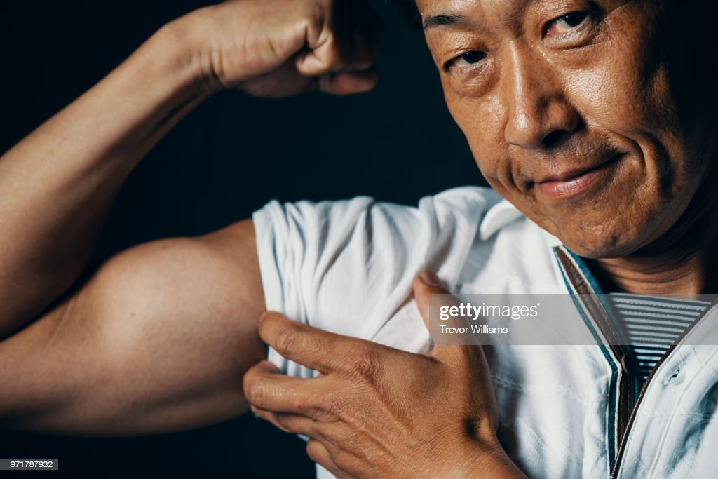 Mature Man Showing His Bicep Muscles Stock Photo Getty Images