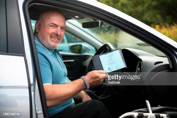 mature man showing his disabled badge - politics and government stock pictures, royalty-free photos & images