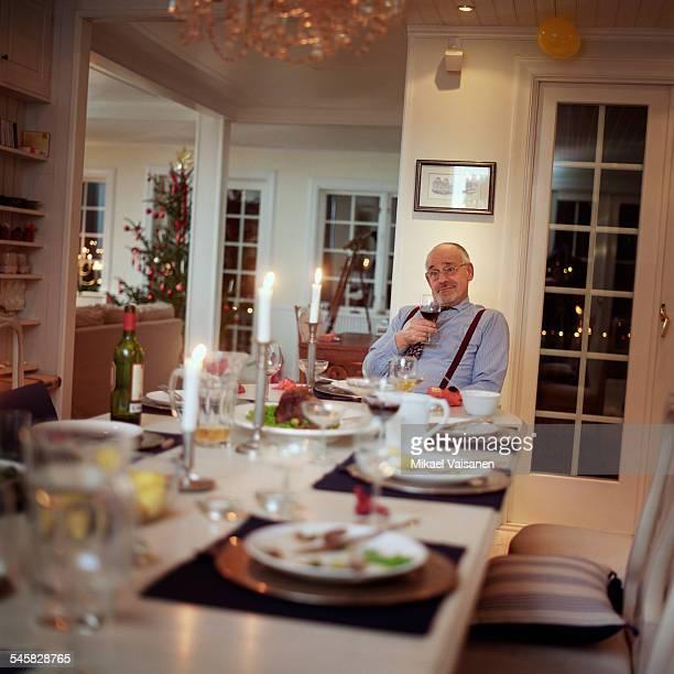 Mature Man Sitting at Table