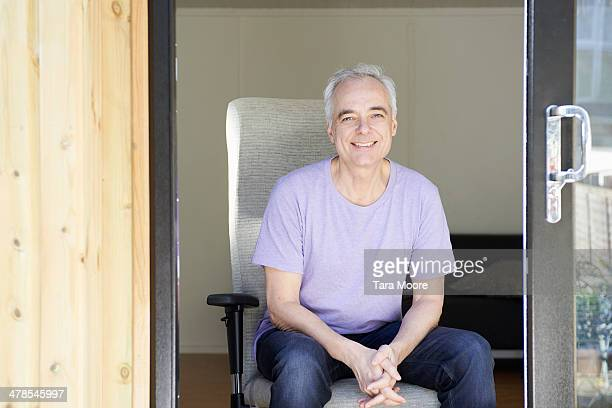 mature man sitting in home office