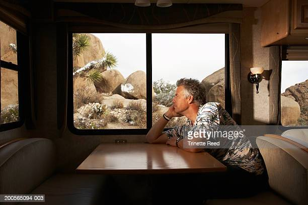 Mature man sitting in motor home