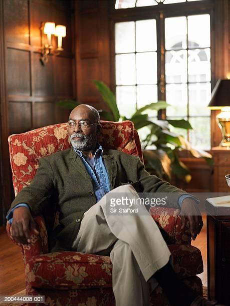 Mature man sitting in study room