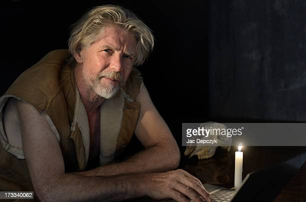 mature man sitting with dead laptop at candlelight - depczyk stock pictures, royalty-free photos & images