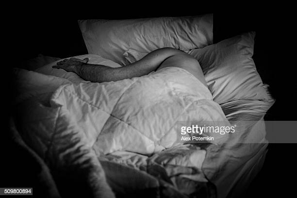 Mature man sleeping in the bed